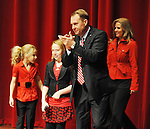 New Mississippi head football coach Hugh Freeze claps as he enters a press conference with his family announcing his hiring at the Ford Center on campus in Oxford, Miss. on Monday, December 5, 2011.  (AP Photo/Oxford Eagle, Bruce Newman)
