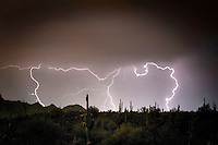 High temperatures and humid days of the summer monsoon season cooks up frequent and spectacular lighting  and dramatic skies in the evening over metropolitan Phoenix, including Fountain Hills, on the east side of the Arizona city.