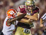 Commissioned by the Associated Press<br /> <br /> Florida State tight end Nick O'Leary, right, drags Clemson corner back Mackensie Alexander to the one yard line in the second half of an NCAA college football game against Clemson in Tallahassee, Fla., Saturday, Sept. 20, 2014.  Florida State defeated Clemson 23-17 in overtime.  (AP Photo/Mark Wallheiser)