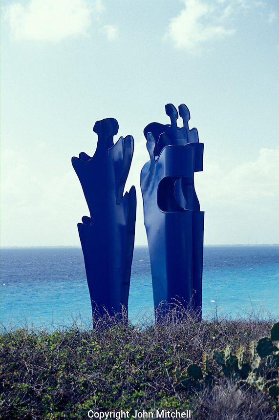 Metal sculpture entitled Isla de Mujeres by Mexican artist Silvia Arana. Located in the Punta Scupture Garden on Isla Mujeres, Quintana Roo, Mexico. This open-air sculpture garden in El Parque Garrafon opened in 2001. Sculptures by 23 Mexican and foreign plastic artists are on display.