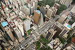 Flying over Avenida Paulista, the city's commercial heart, with its high concentration of helipads..Helicopter pilots serving the growing number of flying businessmen report that often they are requested to pick a passenger in one helipad at the top of a skyscraper and land across the road. Top executives claim they have too much to risk by moving around the city overland, for the time spent in endless traffic jams and for the real risk of kidnapping..