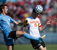 Patrick Mullins (15) of Maryland heads the ball forward past Jonathan Campbell (2) of North Carolina during the game at the Maryland SoccerPlex in Germantown, MD. Maryland defeated North Carolina, 2-1,  to win the ACC men's soccer tournament.