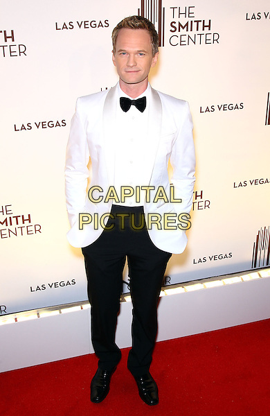 Neil Patrick Harris.Grand opening of The Smith Center for the Performing Arts, Las Vegas, Las Vegas, Nevada, USA, .10th March 2012..full length white jacket black bow tie tuxedo hands in pockets .CAP/ADM/MJT.© MJT/AdMedia/Capital Pictures.