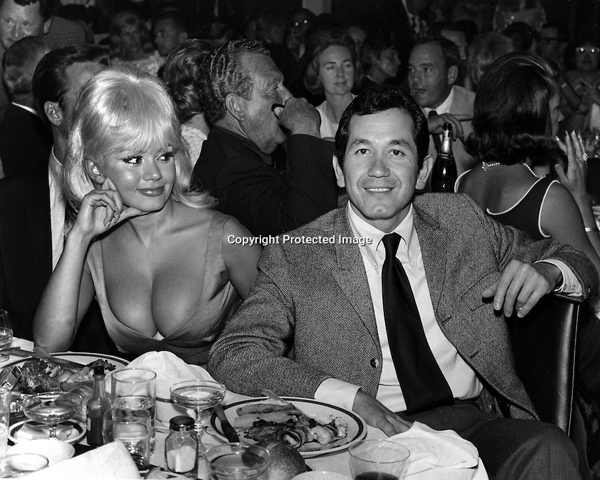 Singer Trini Lopez with toppless star and actresss Yvonne D'angers at celebrity golf tournament in Castro Valley, Ca. (photo by Ron Riesterer)