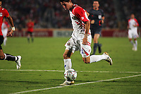 Costa Rica's Bryan Oviedo (14) takes the ball toward goal against Egypt during the FIFA Under 20 World Cup Round of 16 match at the Cairo International Stadium on October 06, 2009 in Cairo, Egypt.