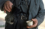 Marsh Arabs. Southern Iraq. Circa 1985. Marsh Arab man pouring coffee.