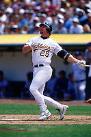 OAKLAND, CA - Mark McGwire of the Oakland Athletics bats during a game at the Oakland Coliseum in Oakland, California on April 27, 1997. Photo by Brad Mangin