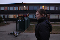 Lucina walks back from the laundry room. She is usually too afraid to walk in the camp at night so only time she is able to run errands is while David naps.<br /> <br /> Walking around the grounds alone makes her uncomfortable. Men stare out the windows of the barracks of their rooms.&quot;I am afraid of men because of what <br /> happened,&quot; she said. When a man came to change a light bulb in her room she waited outside until it was fixed and during her initial police interview the presence of a male translator made her nervous.