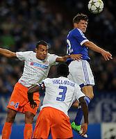 FUSSBALL   CHAMPIONS LEAGUE   SAISON 2012/2013   GRUPPENPHASE   FC Schalke 04 - Montpellier HSC                                   03.10.2012 Klaas Jan Huntelaar (FC Schalke 04) gegen Hilton (li) und Mapou Yanga-Mbiwa (Mitte, beide MHSC)