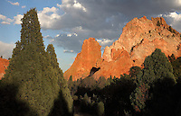 Narrow vertical fin formations with rock climbers, at the Garden of The Gods, an area of geological rock formations protected as a public park, near Colorado Springs, Colorado, USA. The formations are the result of vertical tilting due to the uplift forces of the Rocky Mountains and the Pikes Peak massif, of the horizontal layers of sandstones, conglomerates and limestones, resulting after erosion in the formation of fins and pinnacles. Native Americans have visited the area since 1330 BC and camped here since 250 BC, sheltering under the cliffs and producing rock art. The Garden of the Gods was listed as a National Natural Landmark in 1971. Picture by Manuel Cohen