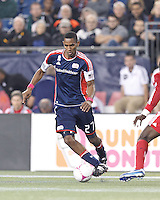 New England Revolution forward Jerry Bengtson (27) dribbles. In a Major League Soccer (MLS) match, the New England Revolution (blue) defeated Chicago Fire (red), 1-0, at Gillette Stadium on October 20, 2012.
