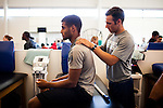 FRESNO, CA - AUGUST 11, 2014:   Fresno State receiver Justin Allen, left, gets a massage from trainer Brain Rand after morning practice. CREDIT: Max Whittaker for The New York Times
