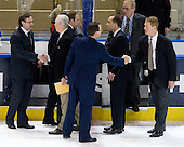 The coaches shake hands by the benches. The Boston College Eagles defeated the Air Force Academy Falcons 2-0 in their NCAA Northeast Regional semi-final matchup on Saturday, March 24, 2012, at the DCU Center in Worcester, Massachusetts.