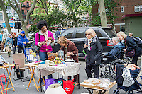 Shoppers search for bargains at the humongous Penn South Flea Market in the New York neighborhood of Chelsea on Saturday, May 21, 2016. The flea market appears like Brigadoon, only once every year, and the residents of the 20 building Penn South cooperatives have a closet cleaning extravaganza. Shoppers from around the city come to the flea market which attracts thousands passing through.  (© Richard B. Levine)