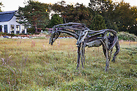 Horse sculpture, garden art by Deborah Butterfield in meadow garden lawn substitute