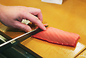 Tokyo, Japan - Japanese Sushi Chef, Nogami Shinji slices raw fish with his very sharp knife : Japanese Sushi Chef, Nogami Shinji, established his own Sushi restaurant in 2001 called &quot;Nogami&quot; in the Hacchobori district of Tokyo. He started his career 25 years ago and continues to master the culinary craft to make the perfect sushi. His father, also a sushi chef, and his son who is currently in training to become a sushi chef shows illustrate how the art of making sushi has been passed down through generations. Nogami's day begins in the very early morning hours when he selects fish at the Tsukiji market. Choosing the best fish is considered the most important part of his work and he makes sure that he always has about 30 different varieties from which to serve. His restaurant is open late until 10pm and many regulars stay even later so Nogami will usually take an afternoon sleep break between 2pm-5pm when the restaurant is closed. ....Nogami-san's hobby is also fishing and he lives in the Tokyo Bay area so can do this in his free time. He usually releases what he catches though as he is worried that the Tokyo Bay water is not so clean. His son trains, works and sleeps at a different restaurant which is normal for a junior. As he improves his technique he will start to help more in his father's restaurant and eventually take over. There are no exams or text books for sushi chefs so this learning is all based on experience. Nogami's wife also helps out in the restaurant when she has time when their young daughter is at school.....Nogami often serves non-Japanese customers and he is surprised that &quot;They can eat anything and they often use heaps of wasabi&quot;. He is proud of his &quot;Aritsugu&quot; knife which is worth about $700 and his most important tool. ....Nogami-san is worried that since the great March 11 earthquake and tsunami, the cost of fish has soared. (Photo by Yosuke Tanaka/AFLO)