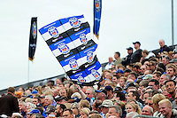 A Bath Rugby supporter in the crowd waves a giant flag in support. Aviva Premiership match, between Bath Rugby and Worcester Warriors on September 17, 2016 at the Recreation Ground in Bath, England. Photo by: Patrick Khachfe / Onside Images