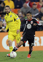 WASHINGTON, DC - OCTOBER 20, 2012:  Andy Najar (14) of D.C United moves away from Eddie Gaven (12) of the Columbus Crew during an MLS match at RFK Stadium in Washington D.C. on October 20. D.C United won 3-2.