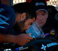 Friday, August 1 2008.  UCSD PhD students Nima Ghod and Gideon Prior of the San Diego IBotix Autonomous Underwater Vehicle team make some last minute adjustments to there vehicle before the start of the AUVSI Underseas Eleven competion.