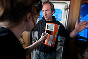 Jacob Namminga , radiation safety advisor with Greenpeace, is checked for radiation during a 'radiation decontamination' drill, as the ships sails up the eastern coast of Japan on her way to Fukushima, in Japan, Monday 2nd May 2011.