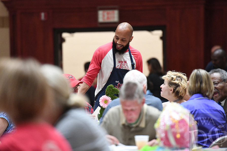 NWA Democrat-Gazette/J.T. WAMPLER Carl Dunn of Fayetteville visits with guests Saturday April 15, 2017 at the Annual M&N Augustine Foundation Easter Feed at Central United Methodist Church in Fayetteville. The foundation feeds an estimated 6,000 people during annual event. The Easter Feed started nearly 20 years ago when Merlin Augustine and the Augustine family decided to expand their annual Easter dinner to include members of the community.