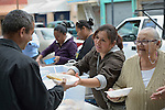 """Juani Martinez and Maria Natividad Granados, both Methodist women in Nuevo Laredo, Mexico, serve food to Cuban immigrants in that city's Plaza Benito Juarez on March 3, 2017. Hundreds of Cubans are stuck in the border city, caught in limbo by the elimination in January of the infamous """"wet foot, dry foot"""" policy of the United States. They are not allowed to enter the U.S. yet don't want to return to Cuba. Many of the city's churches have become temporary shelters for the immigrants, and congregations rotate responsibility for feeding the Cubans, who have slowly been forced to appreciate Mexican cuisine. Such solidarity from ordinary Mexicans is being tested these days, as not only are the Cubans stuck at the border, but the U.S. has stepped up deportations of Mexican nationals, while at the same time detaining many undocumented workers from other nations and simply dumping them on the US-Mexico border. Martinez is a member of the Aposento Alto Methodist Church in Nuevo Laredo. Granados is a member of the El Ebenezer Methodist Church."""