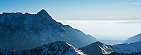Krivan - 2494 m / 8182 ft rises above valley fog, Tatra Mountains Poland/Slovakia