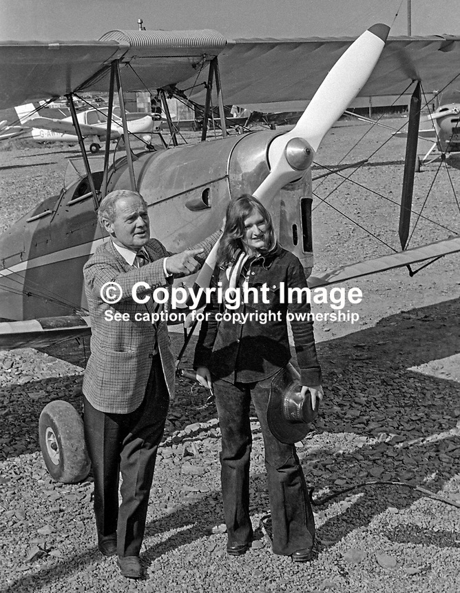 Wartime flying hero Group Captain Douglas Bader, at Newtownards Airfield, N Ireland, to declare open the Ulster Flying Club's new clubhouse pictured in front of a Tiger Moth with club member, Jane Galloway, 20 years, from Holywood, Co Down. 197504750356DB2 .<br /> <br /> Copyright Image from Victor Patterson, 54 Dorchester Park, Belfast, UK, BT9 6RJ<br /> <br /> t: +44 28 90661296<br /> m: +44 7802 353836<br /> vm: +44 20 88167153<br /> e1: victorpatterson@me.com<br /> e2: victorpatterson@gmail.com<br /> <br /> For my Terms and Conditions of Use go to www.victorpatterson.com