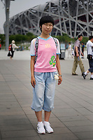 Zhaoregu, a student, age 15, poses for a portrait in Beijing. Response to 'What does China mean to you?': 'The full name of China is the People's Republic of China. To a Chinese person, China represents the personality and unity of all of the races that China is composed of. China is an ancient country. As a Chinese person, this is my pride.'  Response to 'What is your role in China's future?': 'To be a middle school student. I hope to become a creative person who will influence the culture of Chinese people. Furthermore, I want to make my own contribution to an even more prosperous future for China!'