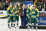 ST CHARLES, MO - MARCH 19:  Captains from the Clarkson Golden Knights are presented with the First Place trophy at the conclusion of the Division I Women's Ice Hockey Championship held at The Family Arena on March 19, 2017 in St Charles, Missouri. Clarkson defeated Wisconsin 3-0 to win the national championship. (Photo by Mark Buckner/NCAA Photos via Getty Images)