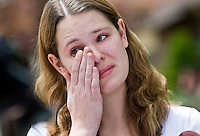 Ashley Kerbs, a daughter-in-law of Wendy Kerbs talks to news media about her mother-in-law who was killed by a drunk driver who went up onto her lawn while she was planting flowers in the front yard of her home in Roy, Utah, Thursday, May 14, 2009.  Ashley said she died in the arms of her husband Marlin, who had left her side seconds before the crash to grab a hose to water the flowers she was planting. August Miller, Deseret News .