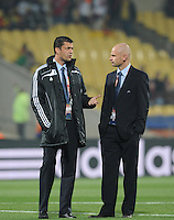 Referee Viktor Kassai and Fourth Official Michael Hester, discuss procedure during their pre-match inspection of the pitch. Ghana defeated the U.S., 2-1, in extra time to advance to the quarterfinals, Saturday, June 26th, at the 2010 FIFA World Cup in South Africa..