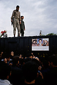 "Tehran, Iran .June 7, 1989..Hundreds of mourners visit and touch the tomb  of the Grand Ayatullah Sayid Ruhullah Musawi Khomeini in the Beheht-E-Zahra cemetery the morning following his funeral. Flowers are dropped by helicopters from above and women have soldiers guarding the tomb touch their babies to it's walls as a blessing. He died of heart attack on June 3, 1989...Khomeini was a senior Shi`i Muslim cleric, Islamic philosopher and marja (religious authority), and the political leader of the 1979 Iranian Revolution that saw the overthrow of Mohammad Reza Pahlavi, the last Shah of Iran. Following the revolution, Khomeini became the country's Supreme Leader?the paramount political figure of the new Islamic Republic...Khomeini was a marja al-taqlid, (source of imitation) and important spiritual leader to many Shia Muslims. He was also an innovative Islamic political theorist, most noted for his development of the theory of velayat-e faqih, the ""guardianship of the jurisconsult (clerical authority)"". He was named Time's Man of the Year in 1979 and also one of Time magazine's 100 most influential people of the 20th century."