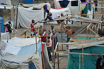 Families continue to pour into a camp for homeless families, constructing new temporary shelters, in the Belair section of Port-au-Prince, Haiti. The country was wracked by a devastating earthquake on January 12, 2010.