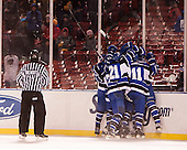 The Beacons celebrate a goal. - The University of Massachusetts Boston Beacons defeated the Salem State University Vikings 4-2 (EN) on Tuesday, January 7, 2014, at Fenway Park in Boston, Massachusetts.