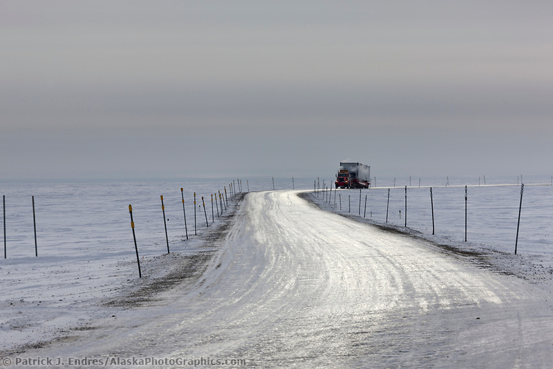 Semi tractor trailer travels the James Dalton Highway near Prudhoe Bay, Arctic north slope, Alaska.