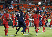 WASHINGTON, DC - July 28, 2012:  Brandon McDonald (4) of DC United heads away from Ezequiel Lavezzi (11) of PSG (Paris Saint-Germain) in an international friendly match at RFK Stadium in Washington DC on July 28. The game ended in a 1-1 tie.