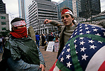 War protesters wearing masks and bloodied clothes protesting the US involvement in the Persian Gulf  and the build up to war against Irag January 15 deadline 1991 Seattle Washington State USA