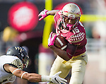 Florida State wide receiver Travis Rudolph sheds Wake Forest defender Jesse Bates III in the first half of an NCAA college football game in Tallahassee, Fla., Saturday, Oct. 15, 2016. (AP Photo/Mark Wallheiser)