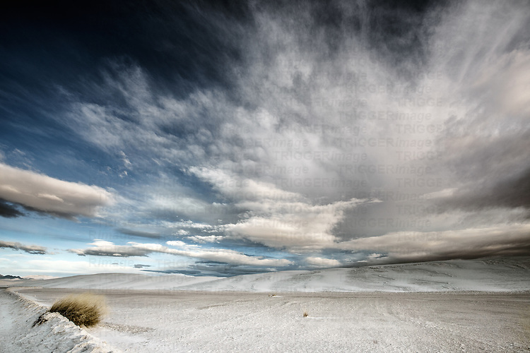American desert scene with white clouds over remote location