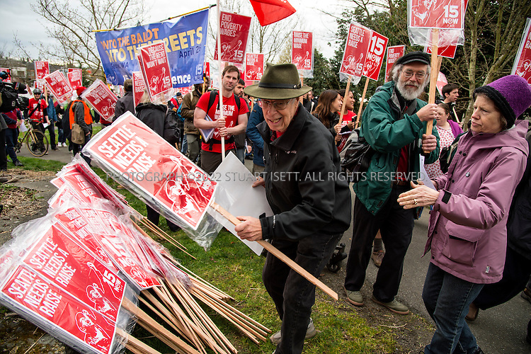 3/16/2014&mdash;Seattle, WA, USA<br /> <br /> A Seattle group started to push for a raise in the minimum wage called &ldquo;$15 Now!&rdquo; held a march  to raise to demand the city council the minimum wage to $15 per hour. Several hundred people marched from Judkins Park in the city&rsquo;s Central District  to Seattle Central Community College on Capitol Hill where a rally was held. Social city council member Kshama Sawant spoke at the rally.<br /> <br /> Here, signs are piled up for marchers to carry at the beginning of the march.<br /> <br /> Photograph by Stuart Isett<br /> &copy;2014 Stuart Isett. All rights reserved.