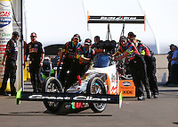 Feb 14, 2016; Pomona, CA, USA; Crew members push NHRA top fuel driver Clay Millican to the starting line during the Winternationals at Auto Club Raceway at Pomona. Mandatory Credit: Mark J. Rebilas-USA TODAY Sports