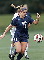 Yale University defender Anna McCahon (11) at midfield. In overtime, Harvard University defeated Yale University,1-0, at Soldiers Field Soccer Stadium, on September 29, 2012.