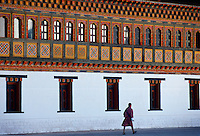 Man walking at the Tashichho Dzong, home of Government, Royal Palace and Religious Centre in Thimpu, the capital of Bhutan.