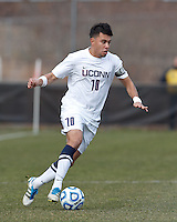 University of Connecticut midfielder Carlos Alvarez (10) on the attack. .NCAA Tournament. Creighton University (blue) defeated University of Connecticut (white), 1-0, at Morrone Stadium at University of Connecticut on December 2, 2012.