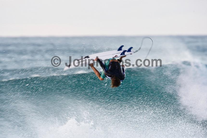 TIM CURRAN surfing at Rocky Point on the North Shore of Oahu, Hawaii. Photo: joliphotos.com