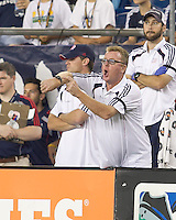 New England Revolution head coach Steve Nicol gestures to referee to watch the time as Chivas USA slows play in extra time. In a Major League Soccer (MLS) match, Chivas USA defeated the New England Revolution, 3-2, at Gillette Stadium on August 6, 2011.