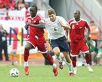 Dwight Yorke of Trinidad outpaces Steve Gerrard of England. England defeated Trinidad & Tobago 2-0 in their FIFA World Cup group B match at Franken-Stadion, Nuremberg, Germany, June 15 2006.