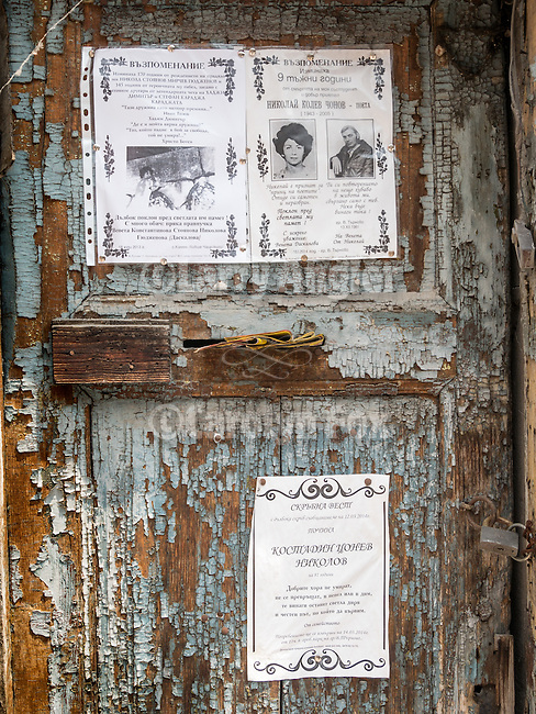 Notices posted on a weathered door along the historic streets of Veliko Tarnovo, Bulgaria