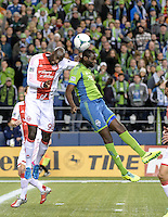 November, 2013: CenturyLink Field, Seattle, Washington:  Portland Timbers defender Mamadou Danso (98) and Seattle Sounders FC defender Djimi Trure (19) jump to head the ball as the Portland Timbers take on the Seattle Sounders FC in the Major League Soccer Playoffs semifinals Round. Portland won the first match 2-1.